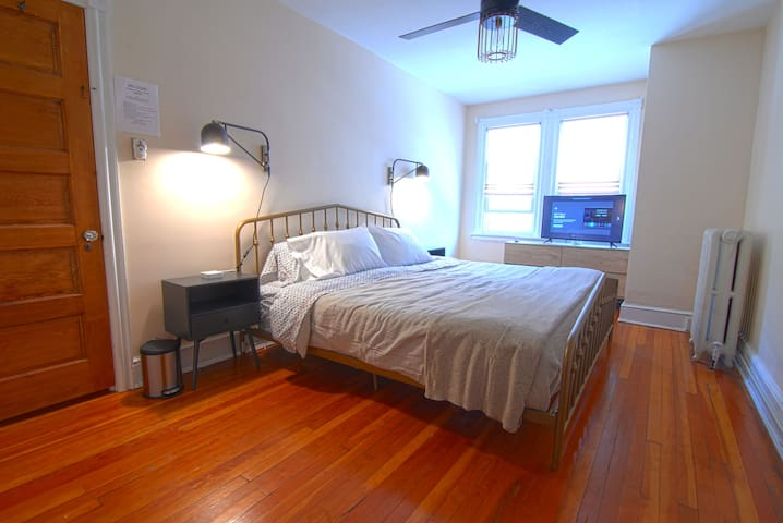 """Bedroom 2 with king sized bed, modern fan, swivel reading lights, dresser, nightstands and 40"""" HDTV with Netflix, Amazon Prime and casting ability."""