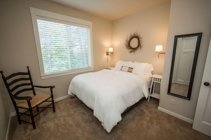 Bedroom #1 Queen bed with seasonal bedding