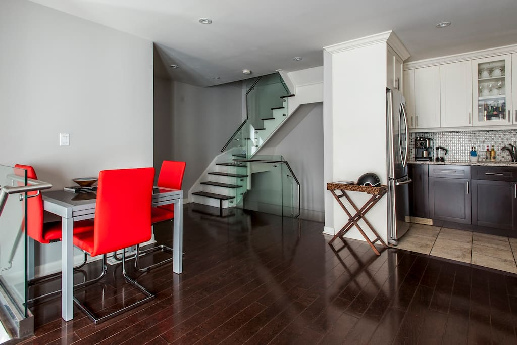 Main floor dining area with a view of the uber modern staircase!