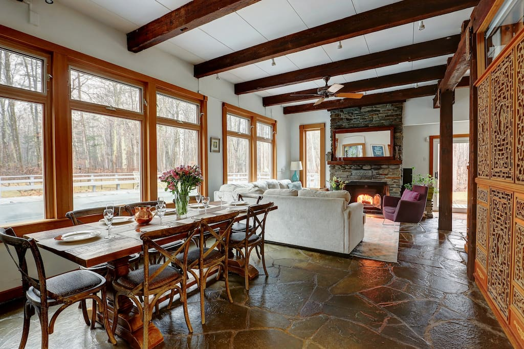 Our main living room. Dine in splendor, surrounded by woods, with the pool shimmering just outside the windows. Note the local bluestone floor.