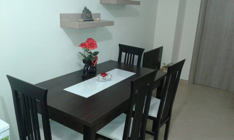 The dining table(in the picture there are four chairs but in fact there are 6)