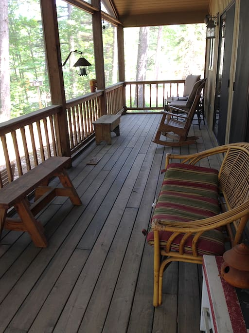 Screened-in deck is a favorite place to relax while watching and listening to the waves.