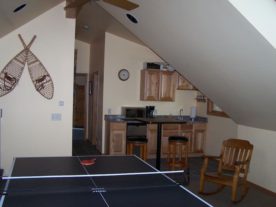 family room with a fold-up ping pong table