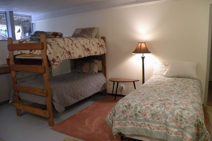 This comfortable, large room has bunk beds and an extra-long twin, it's own sink and the laundry facilities.
