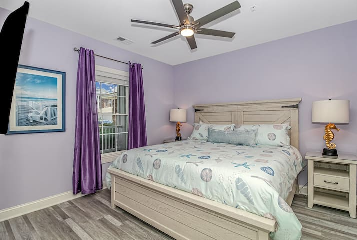 2nd King *Seahorse Suite* with full en-suite bathroom featuring a shower with seats, a laundry washer & dryer.
