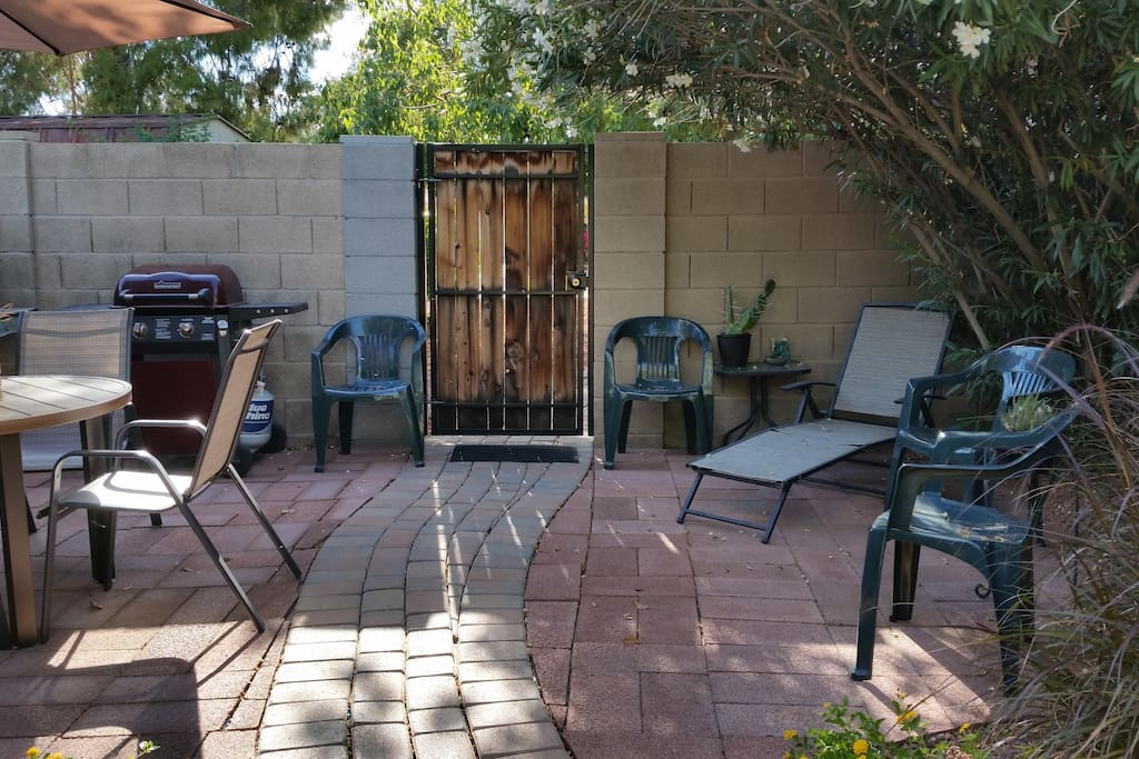 Locking security gate and the patio includes a gas grill and outdoor lounge. Smoking allowed here.