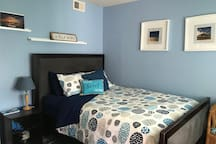 The cozy San Diego Blue room welcomes you home for your stay.