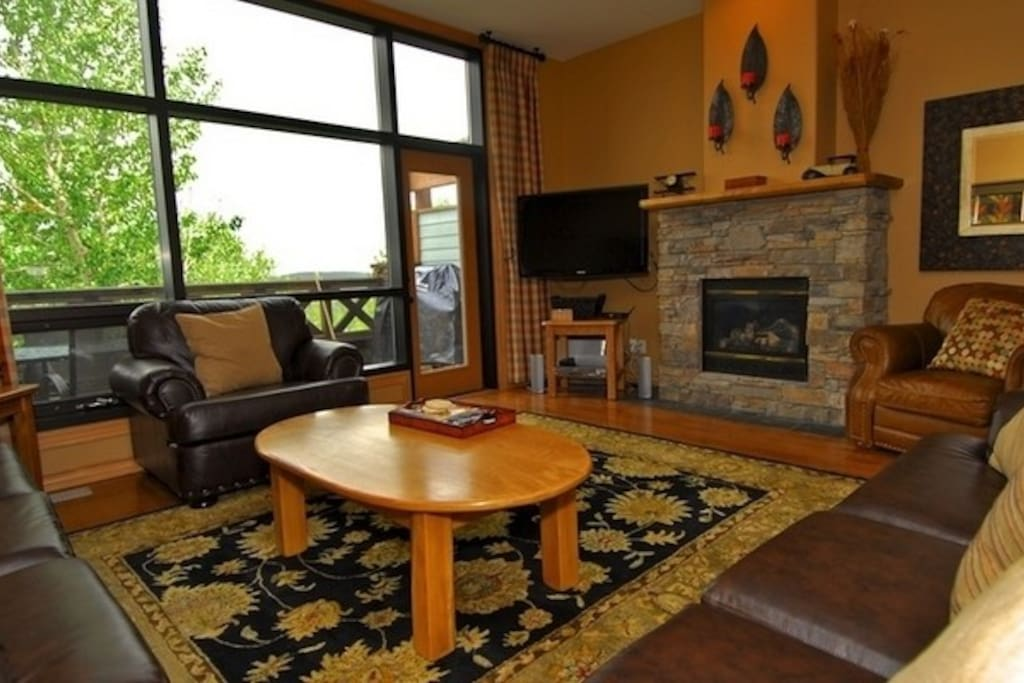 Relax by the beautiful stone fireplace after an awesome day skiing or golfing