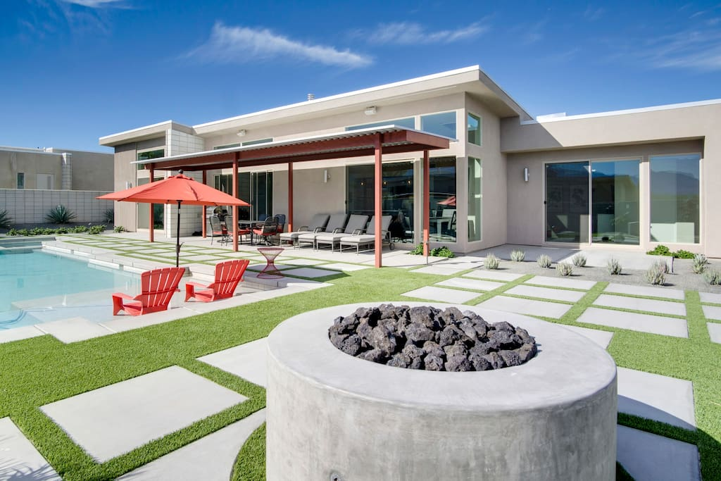 Mid-Century style in the lovely backyard, patio, and pool area.