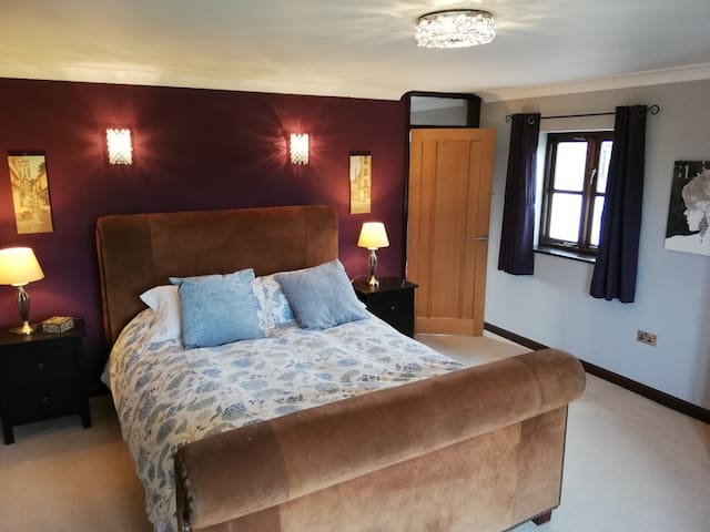 Master en-suite with top brand bed and mattress
