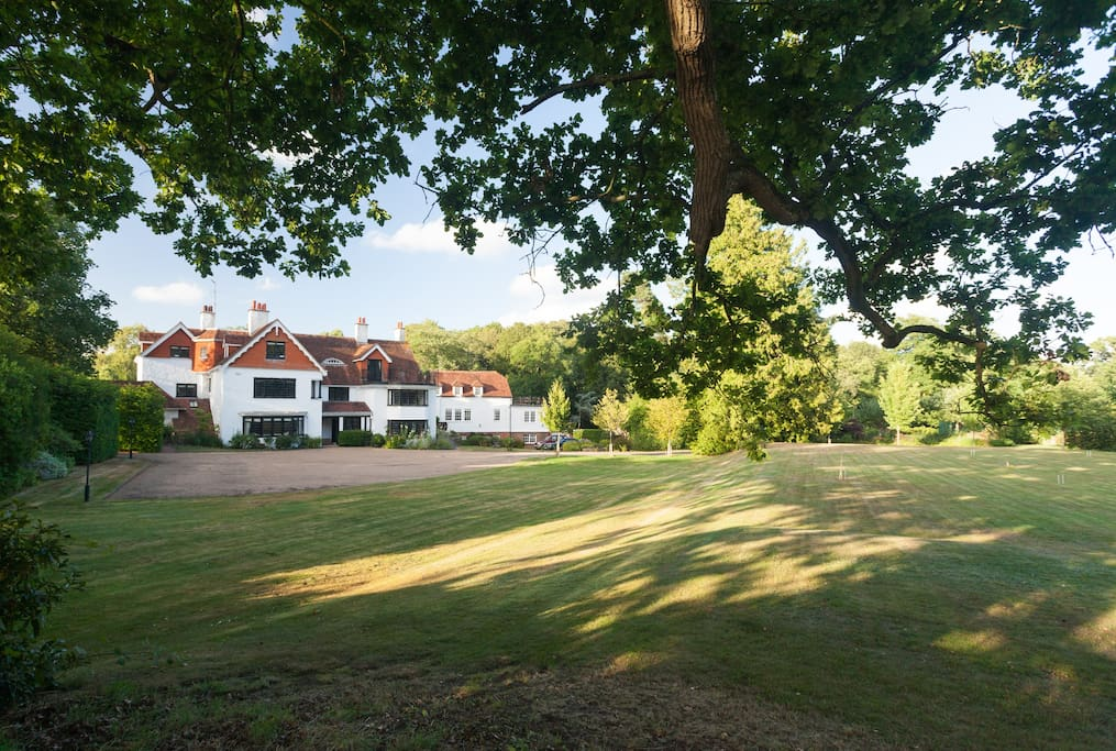 Front of house with croquet and tennis