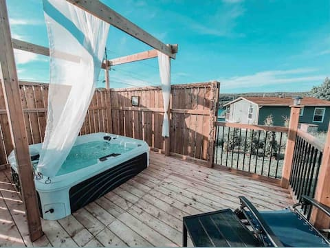 2 bedroom cottage with a hot tub and fire pit