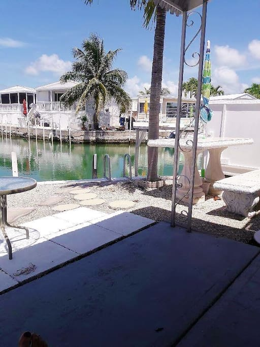 You can sit in the shady spot or in the sun on our back patio! Check out our dock (17ft). It's only two turns down the canal to the ocean!
