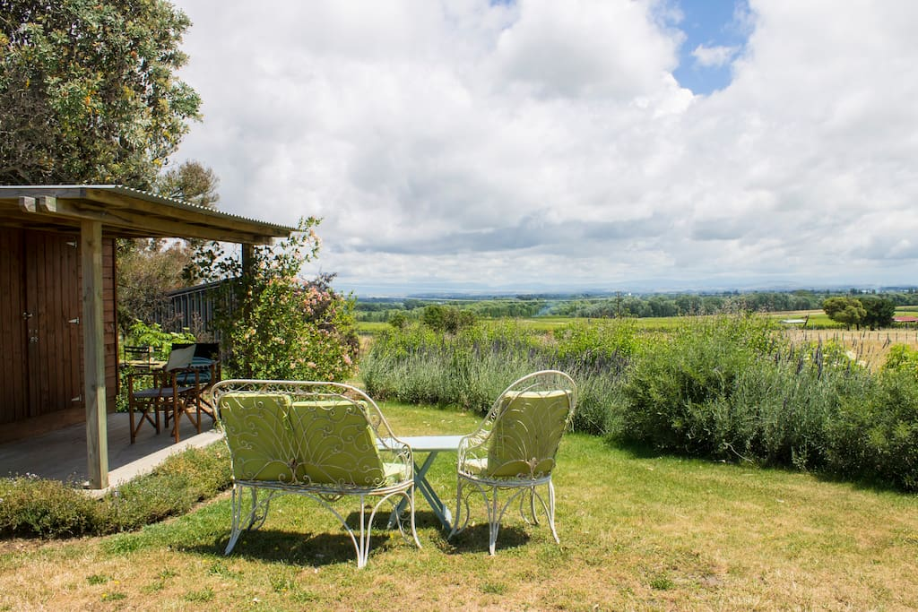 Sit on the deck or the lawn, and look over the plains to the Kaweka ranges (the ranges are covered by cloud in this photo)