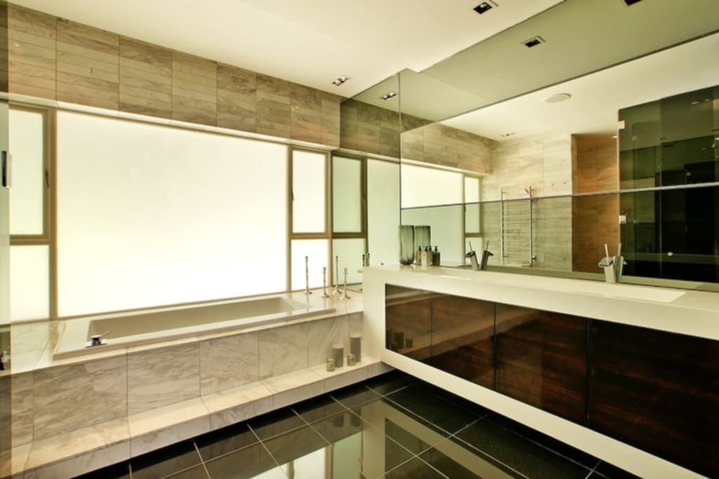 Bathroom with a tub and shower.