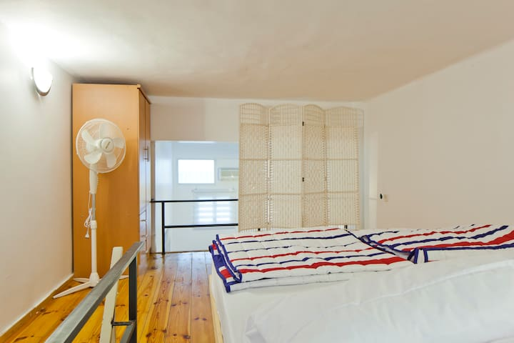 quite and Romantic gallery bedroom, big size Orthopedic mattress, big screen for privace, lots of hangers and drows inside the Closet