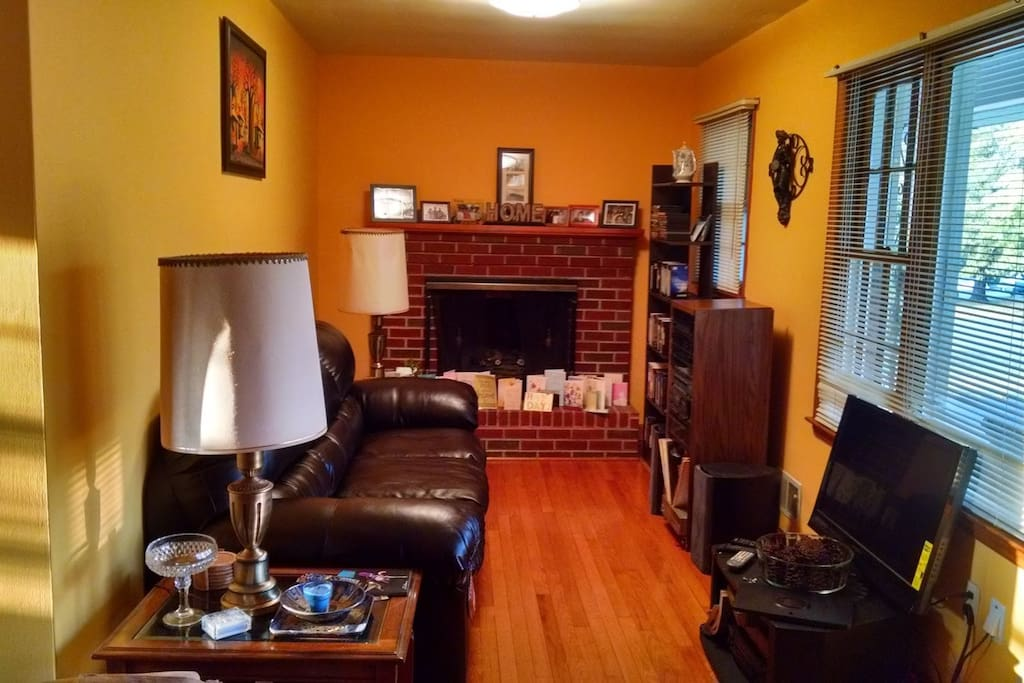 Living room with gas fireplace and satellite television