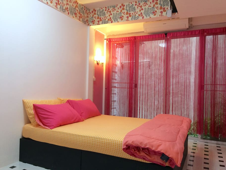 Room 3. A sweet pink tone double-bed-room (queen size) with small porch at the back.