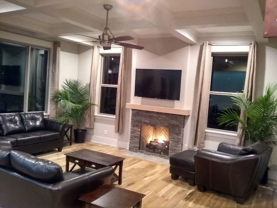 Great room with natural gas fireplace and seating for 7.