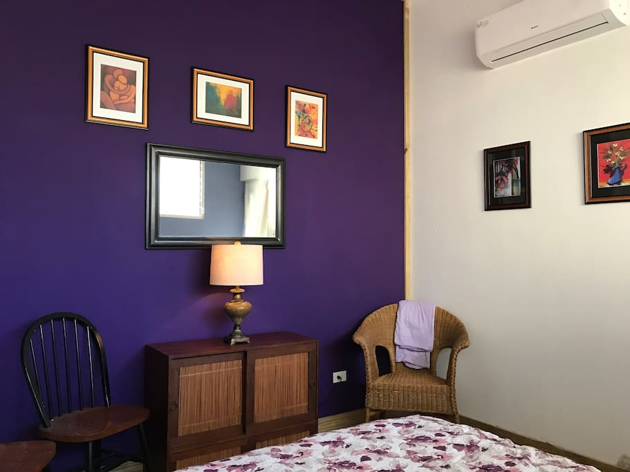 The large bedroom has a Queen-size bed, air conditioner, and a safe deposit box (digital).
