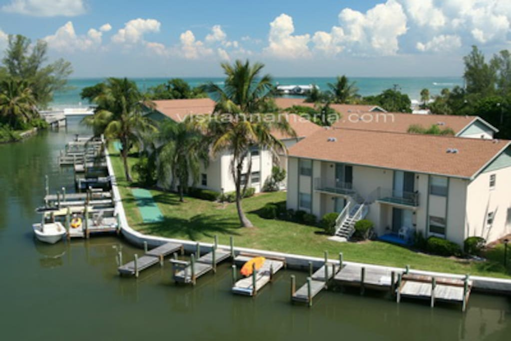 This unit is the lower left of the bldg shown at right. Your dock is 10 steps out your back door.