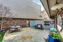 Large enclosed courtyard with outdoor seating to enjoy on a sunny day.