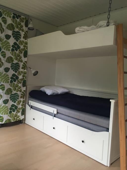 Bedroom with bunkbed and double bed.