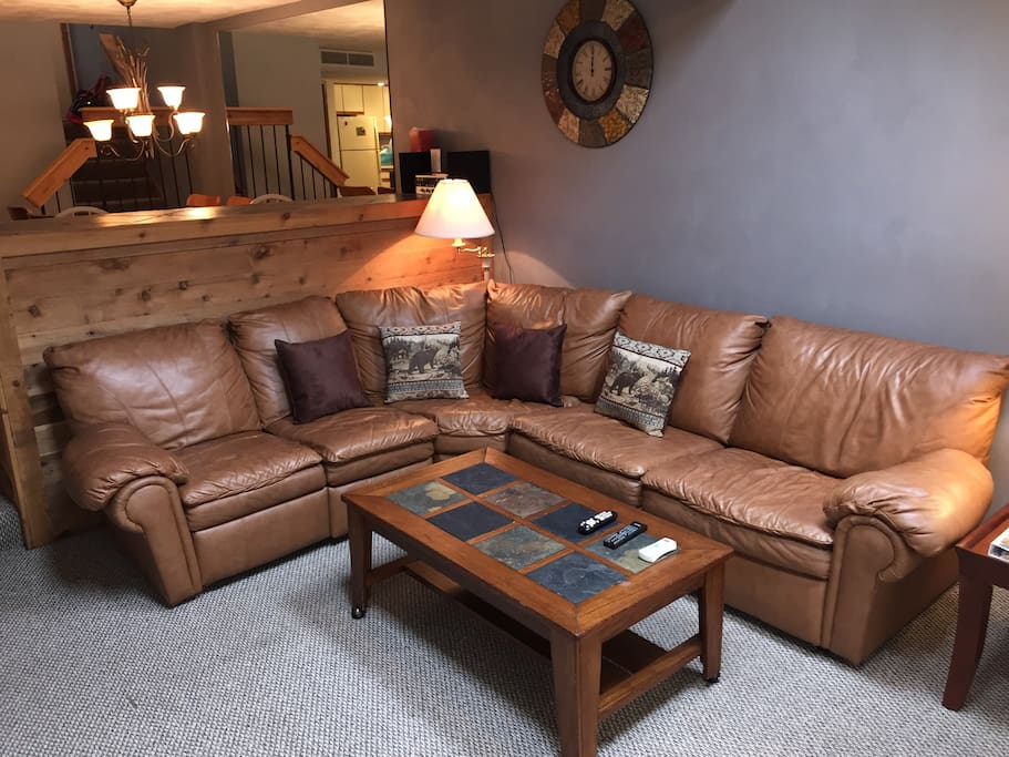 The leather couch in the living room converts to a double bed.