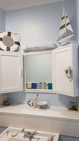 Newly refurbished bathroom with shower and bath