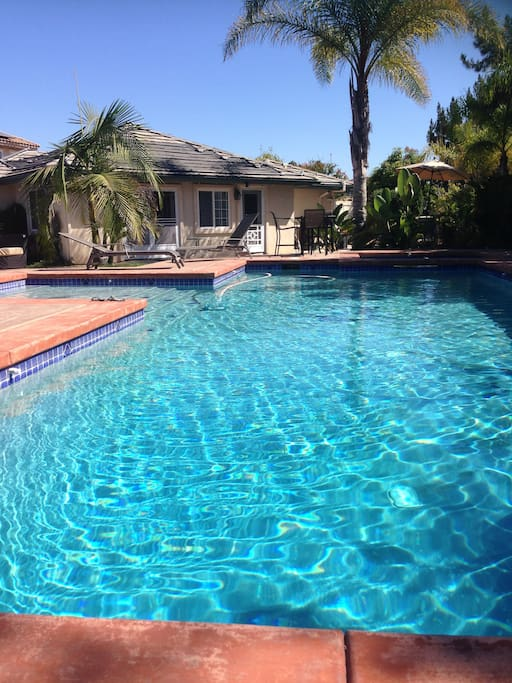Gorgeous, large heated pool with private guest house.