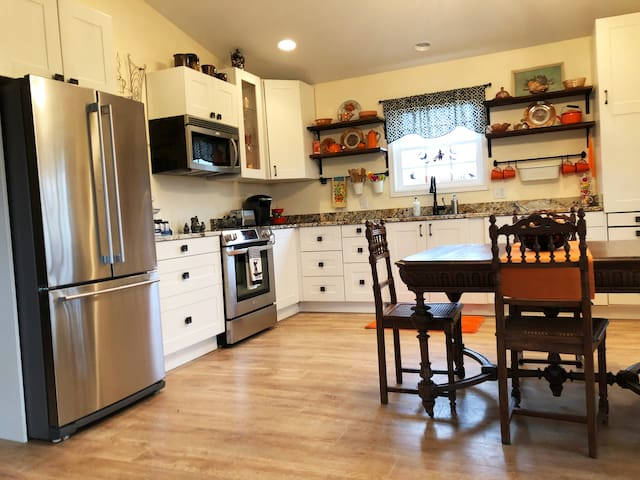 Beautifully appointed fully equipped kitchen with granite counters, stainless appliances and antique table for 4.