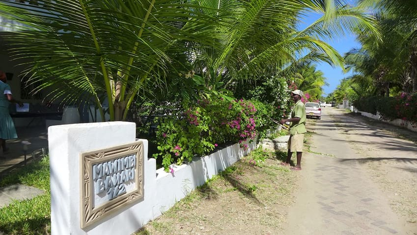 Our whistling gardener and street to the beach.