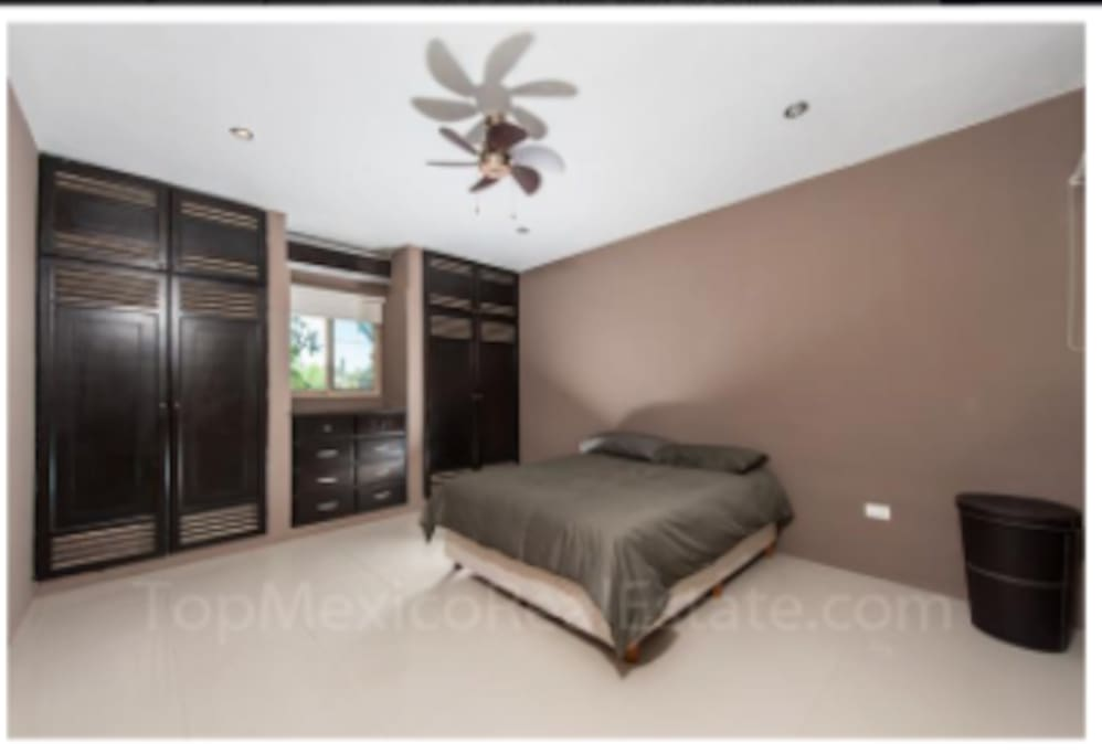 This Master Bedroom has a King size bed and 1 individual bed.