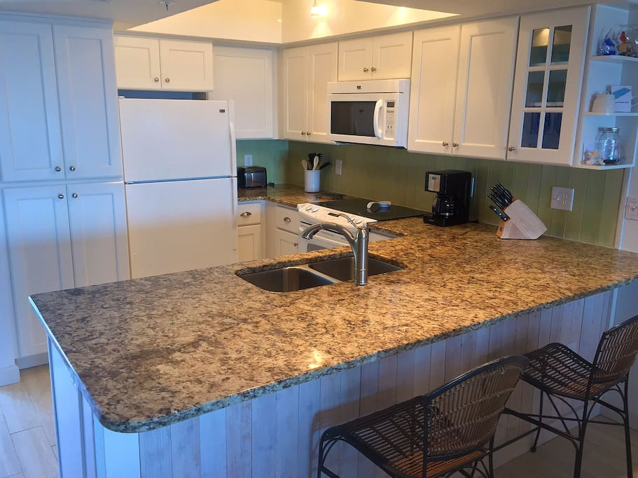 Fully remodeled kitchen with snack bar.