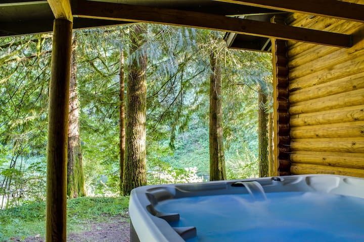 Spacious, riverfront lodge with beach access, private hot tub & forest views!
