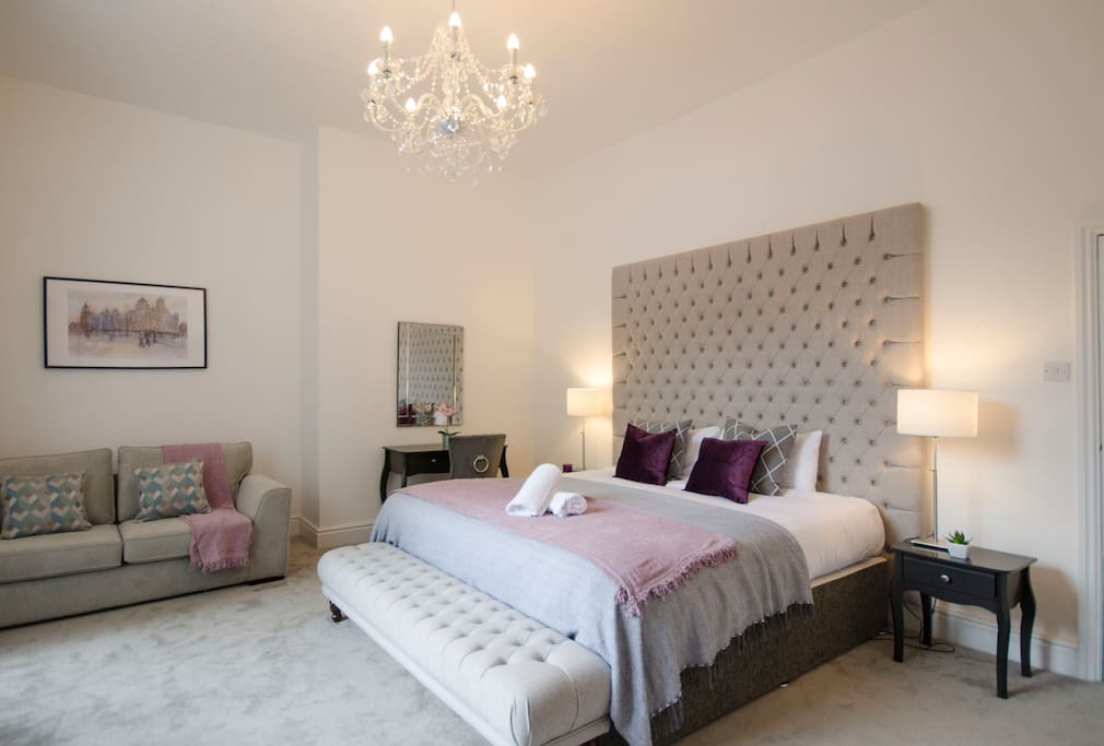 "The stunning master bedroom with super-king size bed, huge chesterfield headboard and 50"" Smart TV as standard."