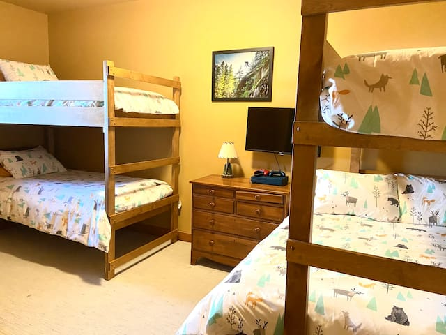 Second bedroom with 3 single beds and a double. Pack 'n play also available.