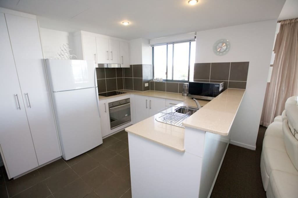 Well equipped kitchen with ocean views & servery to outdoors entertainment area from the window.