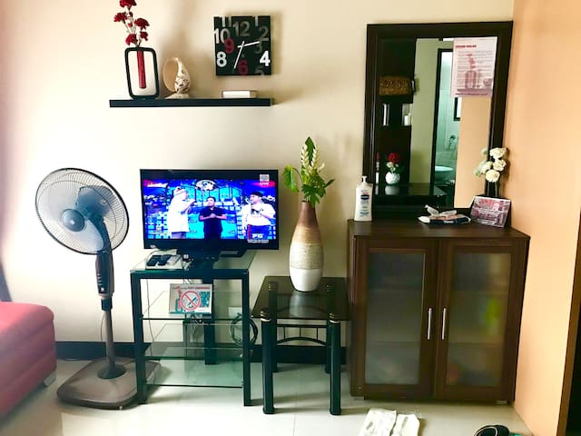 """32"""" flat TV with ABS-CBN """"black box"""" and vanity table with mirror."""