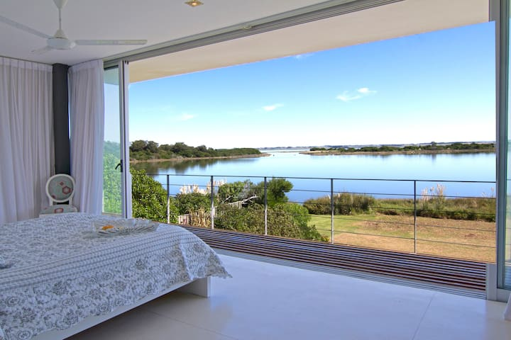Spacious Master suite with full view to the Laguna sunrise and sunset...