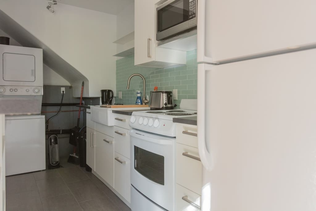 A fully equipped kitchen complete with a washer and dryer.