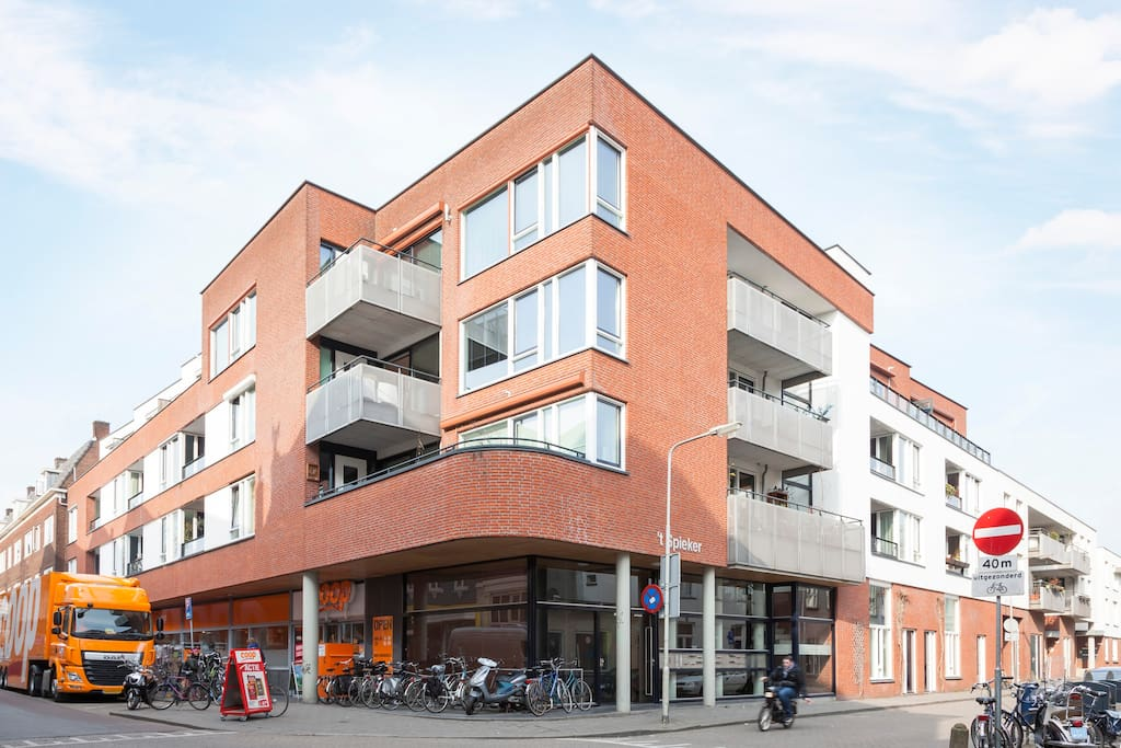Small apartment building with 18 apartments and (very convenient!) a supermarket beneath it
