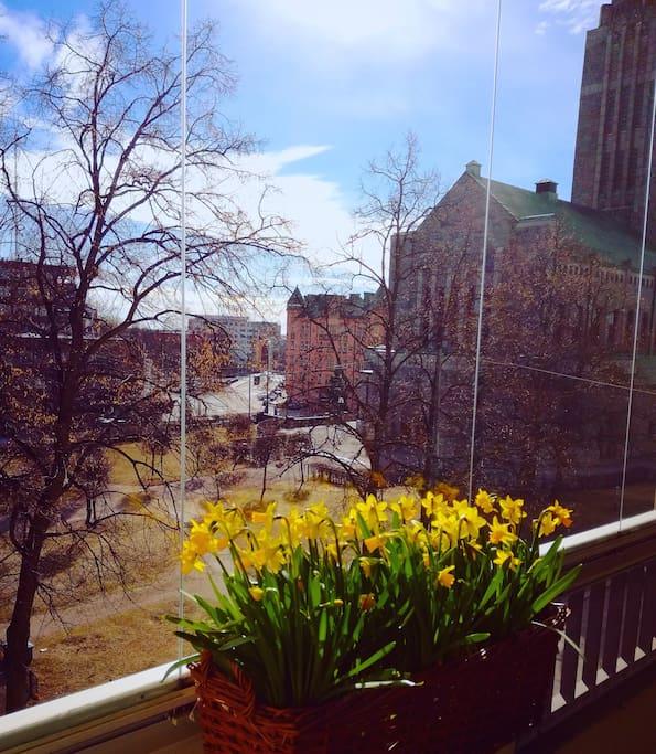 The view of Kallio church through the balcony windows in spring.