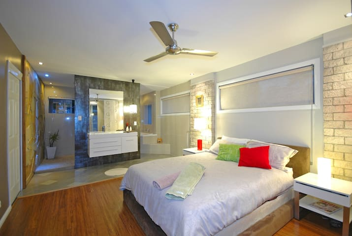 Main bedroom with ensuite and queen bed. Own outdoor private patio.