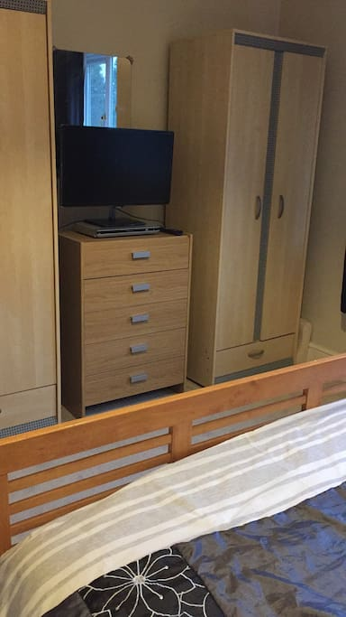 Smart TV with 5 draw chest and two hanging cupboards