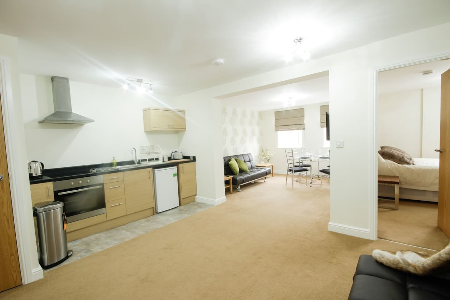 open plan dining living space including two sofa beds