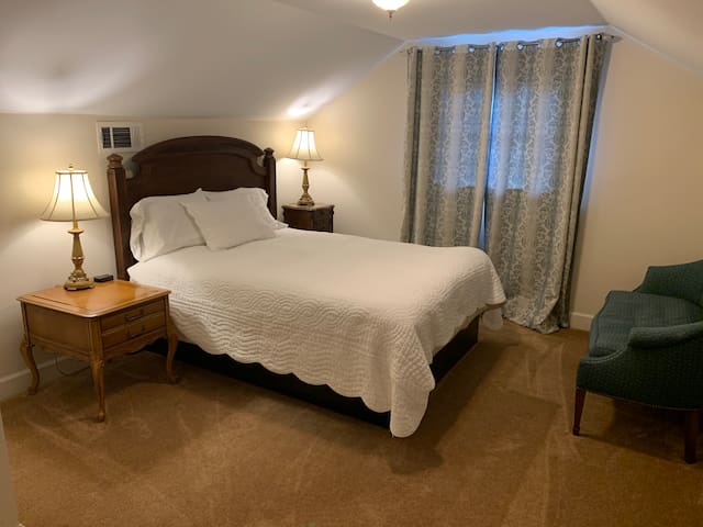 4th Bedroom West, 2nd floor, with feather top Queen size bed with seating.