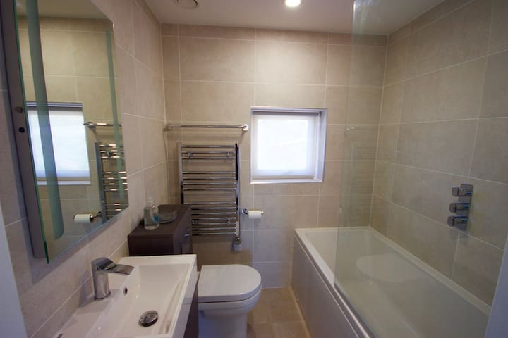 The bathroom has a heated floor, heated towel rail an ecocent air conditioner, and your hot water is heated by solar tubes on the South facing roof.
