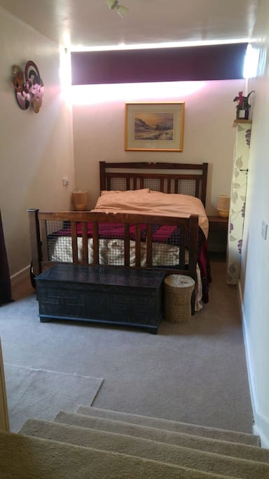 Your bedroom with TV, Freeview, Wifi, Tea & Coffee with easy access to outside.