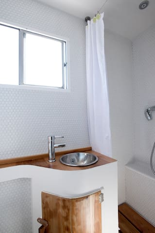 Bathroom equipped with shower, sink and toilet